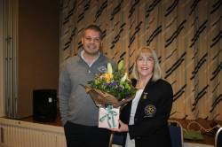 Vice Captain Joe O'Neill presents flowers to Lady Captain Mrs Derval Delargy