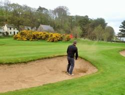 The one handed bunker shot!