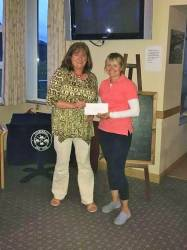 Bronagh Anderson presents second place to Carole Ward