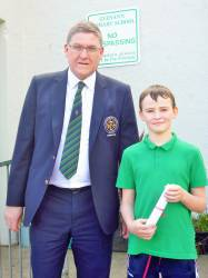 Glenann Primary School 2018 Bursary Winner Caodhan Scullion with Captain Andrew Burns