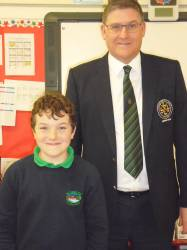 St. Ciaran's Primary School 2018 Bursary Winners Liam Magee with Captain Andrew Burns