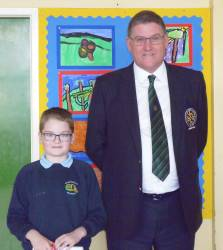 St.Patrick's Primary School 2018 Bursary Winner Charlie O'Neill with Captain Andrew Burns