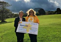 Lady Captain Eveleen McCurry presents £1600 to Heather Miller from Marie Curie